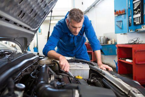 Mechanic testing the engine of car